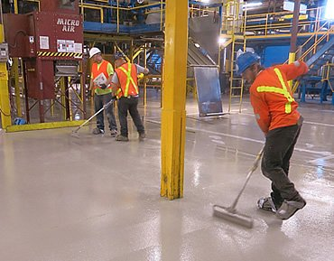 Parking traffic topping and epoxy coating for concrete surfaces by Concrete Polishing and Sealing Ltd., Ottawa